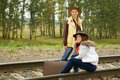 Girls along  railroad rail Royalty Free Stock Photos