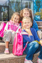 Girls with backpacks in the outside three Royalty Free Stock Photo