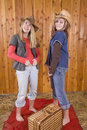 Girls in barn funny faces Stock Photography