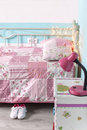 Girls bedroom photo of girl s bed with pattern bedding on it Royalty Free Stock Photos