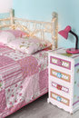 Girls bedroom photo of girl s bed with pattern bedding on it Royalty Free Stock Images