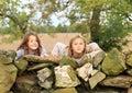 Girls behind wall Royalty Free Stock Photo