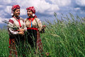 Girls in the Belarusian folk costume on the reconstruction of folk ebrard in the Gomel region. Royalty Free Stock Photo