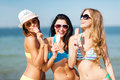 Girls in bikini with ice cream on the beach summer holidays and vacation Royalty Free Stock Images
