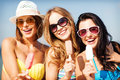 Girls in bikinis with ice cream on the beach Royalty Free Stock Photo