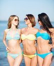 Girls in bikinis walking on the beach summer holidays and vacation concept Royalty Free Stock Photography