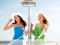 Girls on boat or yacht summer holidays and vacation concept Stock Photo
