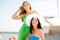 Girls on boat or yacht summer holidays and vacation concept Stock Image