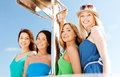 Girls on boat or yacht summer holidays and vacation concept Stock Photography