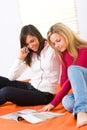 Girls browsing magazine Stock Image
