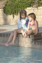 Girls bu the pool Royalty Free Stock Photo