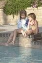 Girls bu the pool Royalty Free Stock Photo