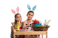 Girls with bunny ears make a wry faces Royalty Free Stock Photo