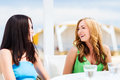 Girls in cafe on the beach summer holidays and vacation Stock Images