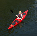 Girls in canoe stockholm sweden july paddling the city of stockholm Royalty Free Stock Photos