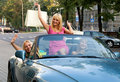 Girls in the car after shopping Royalty Free Stock Photo