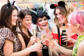 Girls at Carnival parade clinking glasses with champagne Royalty Free Stock Photo
