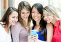 Girls with a cell phone Royalty Free Stock Images
