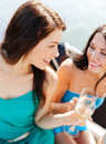 Girls with champagne glasses on boat summer holidays and vacation or yacht Royalty Free Stock Image