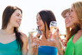 Girls with champagne glasses summer holidays vacation and celebration Stock Images