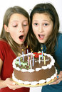 Girls and chocolate cake Royalty Free Stock Image