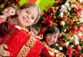 Girls with a Christmas gift Royalty Free Stock Photos