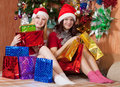 Girls with christmas gifts Royalty Free Stock Images