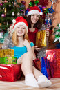 Girls  with christmas gifts Royalty Free Stock Image