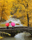 Girls, colorful umbrellas in autumn park. Royalty Free Stock Photo
