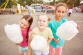 Girls with cotton candy cute eating outdoors Royalty Free Stock Image