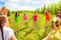 Girls dance in the park in circle Royalty Free Stock Photo