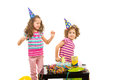 Girls dancing at birthday party happy little against white background Stock Photography