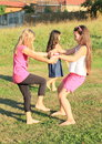 Girls dancing on grass barefoot green meadow Royalty Free Stock Photos