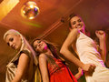 Girls dancing in the night club Stock Photos