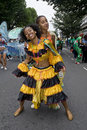 Girls dancing on the street at the carnival Royalty Free Stock Photography