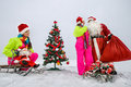 Girls decking up the Christmas tree Royalty Free Stock Photography