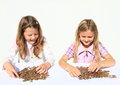 Girls dividing money smiling kids savings of czech crowns small change in hands Royalty Free Stock Image
