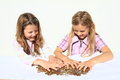 Girls dividing money two kids savings of czech crowns small change in hands Royalty Free Stock Photos