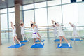 Girls doing gymnastic exercises or exercising in fitness class Royalty Free Stock Photo