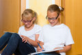 Girls doing homework for school or sisters together at home next day Royalty Free Stock Image
