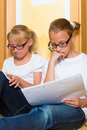Girls doing homework for school or sisters together at home next day Stock Photos