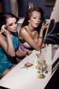 Girls doing make up Stock Photography