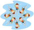 Girls doing synchronised swimming in team Royalty Free Stock Photo