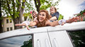 Girls dragging bride in limousines hatch two young Royalty Free Stock Photography
