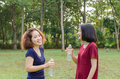 Girls drinking water after excercise two asian from bottle Stock Photography