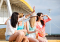 Girls with drinks on the beach summer holidays and vacation Royalty Free Stock Photography