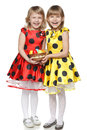 Girls with Easter eggs in a basket Royalty Free Stock Photography