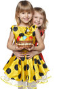 Girls with Easter eggs in a basket Stock Photography