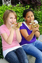 Girls eating pizza Royalty Free Stock Image