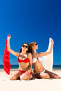 Girls enjoying freedom on the beach Stock Photography
